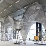 Construction prototype for ultra-thin curved concrete roof that also generates solar power